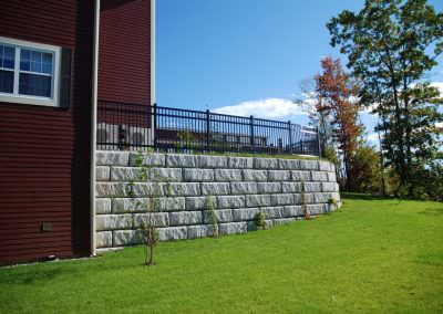 Limestone Retaining Wall with fence